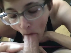 Skinny girl with glasses slurping a cock and masturbating