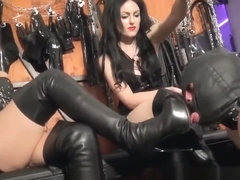 Slave licking boots of hot mistresses