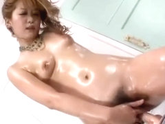 Ohmibod in her pussy with nuru oil