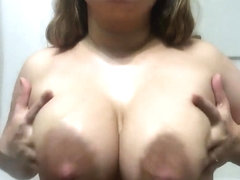 Massaging milky tits with oil