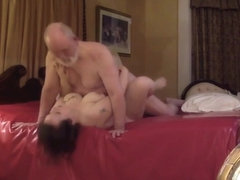 Old guy fucking his younger lover in a hotel