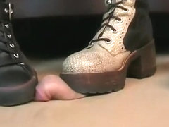 Two bootgirls crush his snake on the hole-board with Converse Chucks Boots