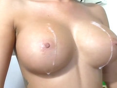 Oksana spitting on her huge silicone boobs