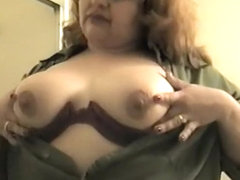 Busty Babe Plays With Her Big Tits
