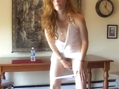 Desperate woman pissing in small cup 03