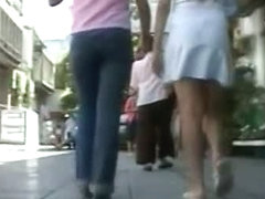 Candid street clip of two teen friends with additional upskirt shots