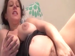 Hot milf with massive tits playing with her juicy pussy
