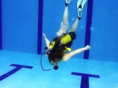 scuba girl in pool