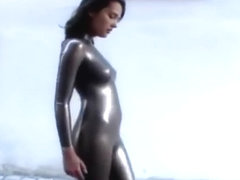 Girl has to walk in latex catsuit on the street because she lost a bet