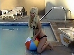 Alexis Paige: Beach Ball Pool Deflate